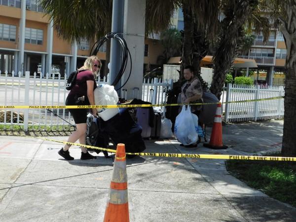 Margarita and Tatiana Halava cart away their stuff.JPG