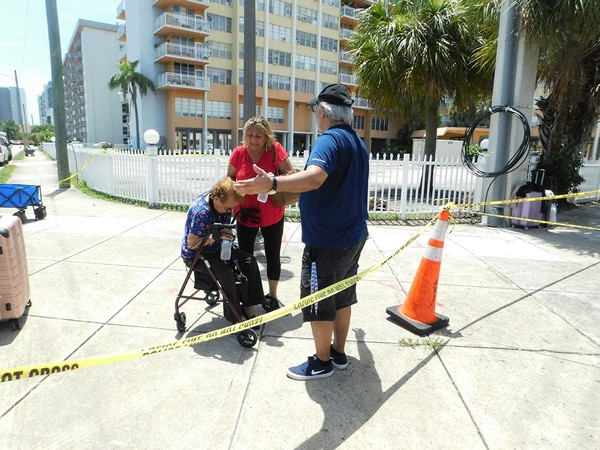 Marylou Rodriguez and Pedro Beltran help their 94-year-old mother, Juana Escobar, leave Crestview.JPG