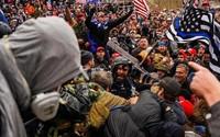 Mike Fanone being beaten in shadow of police flag_Instagram.jpg