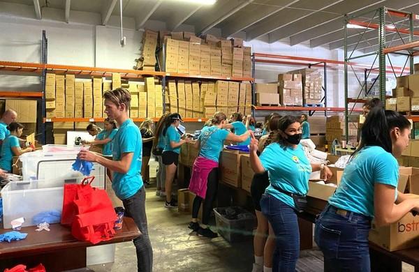 GEM warehouse volunteers.jpeg