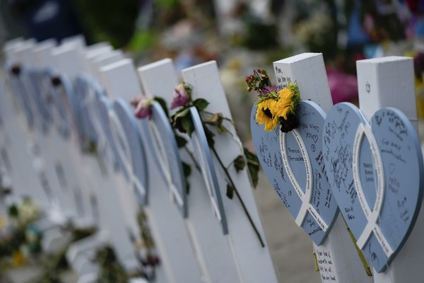 Crosses with flowers by Wall of Hope.jpeg