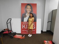 Christine King by a poster.JPG