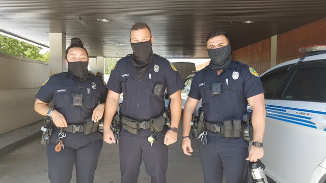 Miami Police officers posing with masks Facebook.jpg
