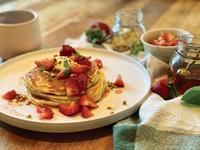 Lemon ricotta pancakes with macerated strawberries