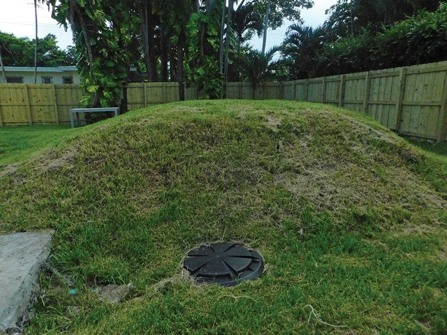 Raised-septic-tank-in-back-yard.jpg