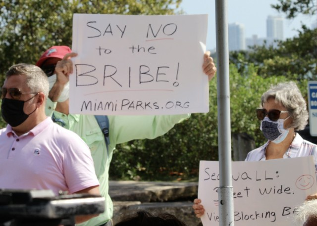 Protesters showed up to the announcement of the plan.jpg